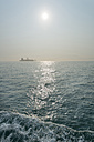 China, Hong Kong, container ship in the back light on the way to Lamma Island - SHF001269