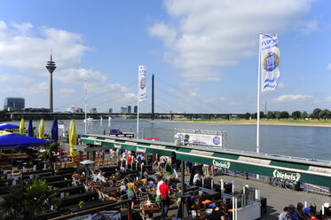 Germany, North Rhine-Westphalia, Duesseldorf, view to cafe at Rhine river promenade in front of Rhine River - MIZ000461