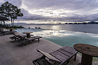 Thailand, Ko Yao Noi, Andaman Sea with swimming pool in foreground - THA000335