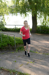 Young woman jogging at stairs - BFRF000407