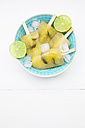 Bowl of caipirinha ice lollies, ice cubes and slices of lime - LVF001222