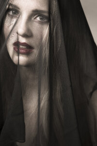 Portrait of young woman wearing mourning veil - FCF000198