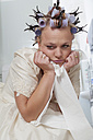 Frustrated bride with curlers sitting on toilet - ECF000612