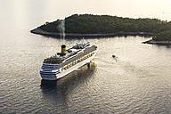 Croatia, Dubrovnik, view to cruise liner Costa Fascinosa in front of Lokrum Island at evening twilight - WE000078