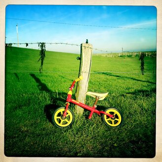 Germany, North Frisia, Langeness, bogie wheel at fence - MMO000020