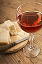 Glass of blush wine and parmesan cheese - CSTF000342