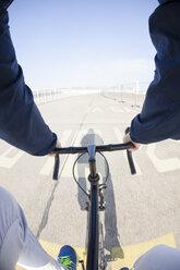 Germany, Berlin, racing biker driving at Tempelhofer Feld formerly Berlin Tempelhof Airport, partial view - MKL000006
