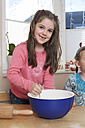 Portrait of little girl stirring dough - ECF000623