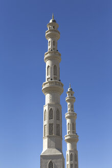 Egypt, Hurghada, two minarets of El Mina Mosque in front of blue sky - STD000093