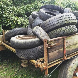 Germany, North Rhine-Westphalia Eifel, old tires on trailer - GWF002764