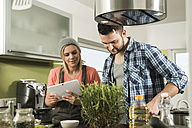 Couple cooking in kitchen at home - UUF000510