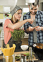 Couple cooking in kitchen at home - UUF000490