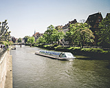 France, Alsace, Strasbourg, L'ill River, View of waterfront with boat - SBD000905