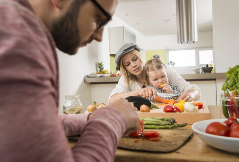 Family cooking in kitchen at home - UUF000551