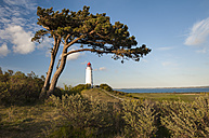 Germany, Mecklenburg-Western Pomerania, Baltic Sea, Lighthouse on Hiddensee island in sunset - RJ000138