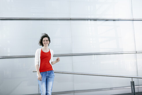 Germany, North Rhine-Westphalia, Cologne, woman standing in front of facade at Rheinauhafen - RHF000342