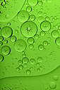 Oil and water in front of green background - MJOF000162