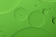 Oil and water in front of green background - MJOF000164