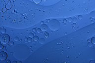 Oil and water in front of blue background - MJOF000165