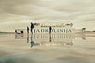 Croatia, Zadar, Waterfront promenade and ferry in the evening - MEM000018