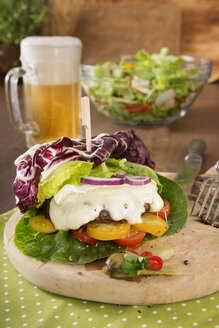 Beef burger with camembert and glass of beer - CSTF000365