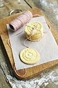 Stack of home made almond cookies on a cutting board - HAWF000180