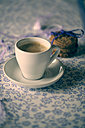 Cup of coffee and chocolate cookies on patterned cloth - SARF000633