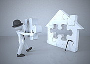 Mannikin with bowler hat building jigsaw puzzle house - ALF000156