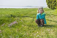 Germany, Mecklenburg-Western Pomerania, Ruegen, Smiling boy on meadow - MJF001255