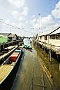 Indonesia, Riau Islands, Bintan Island, Fishing village, Wooden huts and fishing boats - THAF000392