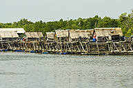 Indonesia, Riau Islands, Bintan Island, Fishing village, Wooden huts - THAF000380
