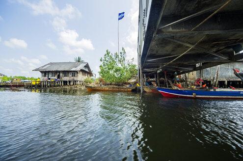 Indonesia, Riau Islands, Bintan Island, Fishing village, Bridge, Fishing hut and flag - THAF000383