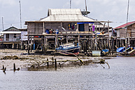 Indonesia, Riau Islands, Bintan Island, Fishing village, Fishing hut and fishing boat - THA000404