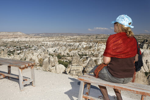 Turkey, Cappadocia, Woman looking over Goreme valley - GF000510