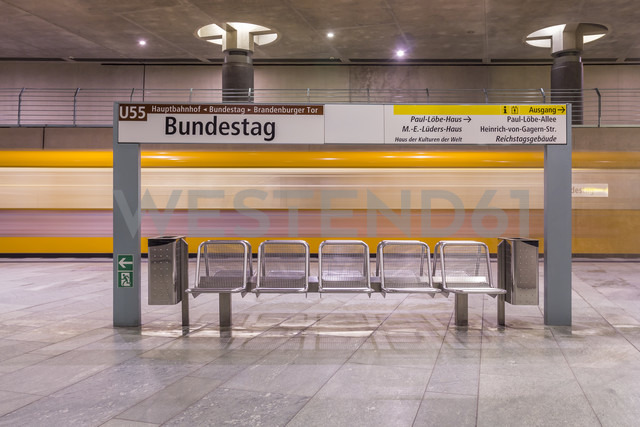 Germany, Berlin, modern architecture of  subway station Bundestag with moving underground train - NKF000118