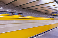 Germany, Berlin, subway station Deutsche Oper with moving underground train - NKF000123