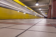 Germany, Berlin, subway station Rathaus Reinickendorf with moving underground train - NKF000144