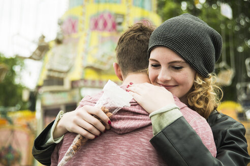 Teenage girl embracing her boyfriend - UUF000622