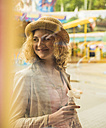 Portrait of smiling teenage girl at fun fair - UUF000631