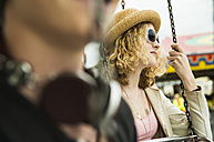 Portrait of teenage girl with sun glasses at fun fair - UUF000617