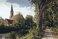 Germany, North Rhine-Westphalia, Telgte, Family biking near river Ems - MEMF000040