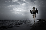 Greece, Corfu, naked young woman on the beach, back view - AJF000035