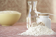 Ingredients of yeast dough and bowl of raw yeast dough on cloth - SABF000017