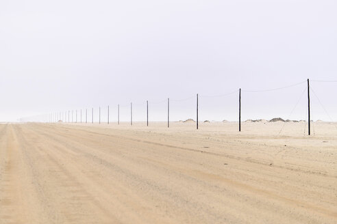 Africa, Namibia, Namib Naukluft area, Dirts track and power lines - HLF000580