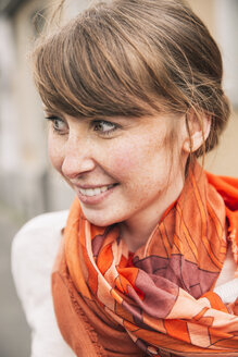Portrait of smiling woman wearing orange scarf - MFF001103
