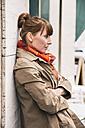 Portrait of waiting woman wearing orange scarf - MFF001102