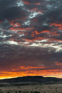 Africa, Namibia, Damaraland, dramatic sky at sunset - HLF000600