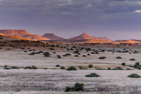 Africa, Namibia, Damaraland, view to grassland and volcanos by sunset - HLF000602