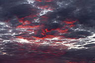Africa, Namibia, Damaraland, dramatic sky at sunset - HLF000607