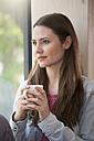 Portrait of creative business woman having coffee break - FKF000550